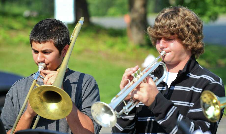 Twin brothers, Kevin, left, and Matt Hannequin, 17, practice outside Bethel High School in Bethel, Conn., during band camp Wednesday, Aug. 21, 2013. Both have been accepted to play in the national All Honor Band in Tennessee this October. Photo: Michael Duffy / The News-Times