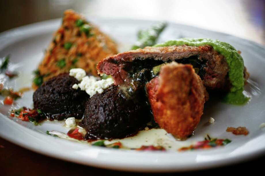 Huitlacoche, which is mere corn fungus, is an ingredient popularly used in preparing quesadillas -- but it also goes with other plates. In this photo, filete del campesino made from tenderloin stuffed with squash, mushrooms, huitlacoche, and chihuahua cheese, topped with tomatillo salsa. Photo: Michael Paulsen, File Photo / Houston Chronicle