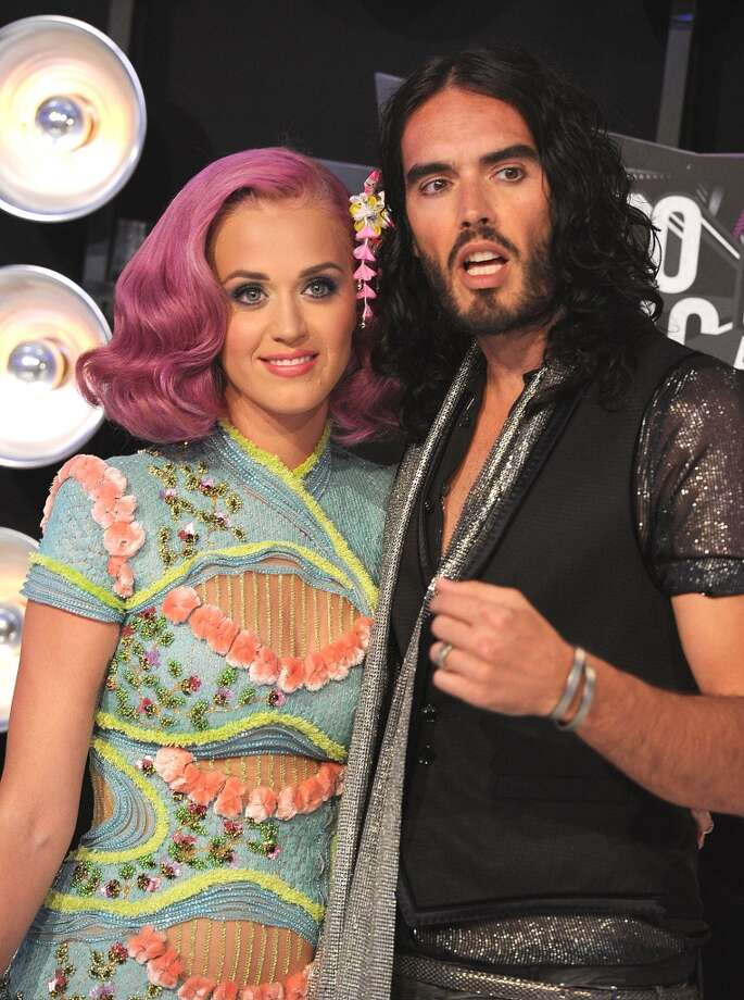 Singer Katy Perry and actor Russell Brand in happier times. Here they are at the 2011 VMAs. Brand filed for divorce a few months later, reportedly telling Perry via text message. Photo: Steve Granitz, WireImage