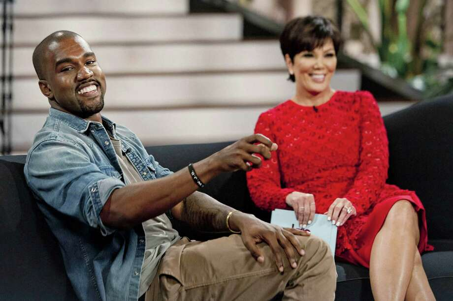 "This Aug. 19, 2013 photo shows singer Kanye West, left, with host Kris Jenner during a taping of her talk show ""Kris,"" in Culver City, Calif. West proclaims his love for Jenner's daughter, Kim Kardashian, and their daughter North in the interview airing Friday, Aug. 23.  (AP Photo/20th Century Television, Barry J. Holmes) ORG XMIT: NYET314 Photo: Barry J. Holmes / 20th Century Television"