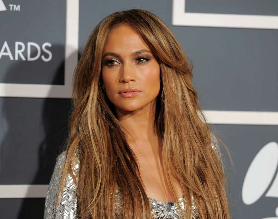 FILE - In this Sunday, Feb. 13, 2011 file photo, Jennifer Lopez arrives at the 53rd annual Grammy Awards in Los Angeles. Police say an intruder had been living for a week on Lopez's property in the Hamptons while she was away. Southampton police said Wednesday, Aug. 21, 2013, the entertainer had an order of protection against 49-year-old John Dubis of Rhode Island. Information on why the order was obtained wasn't immediately available. (AP Photo/Chris Pizzello, File) ORG XMIT: NY110 Photo: Chris Pizzello / AP