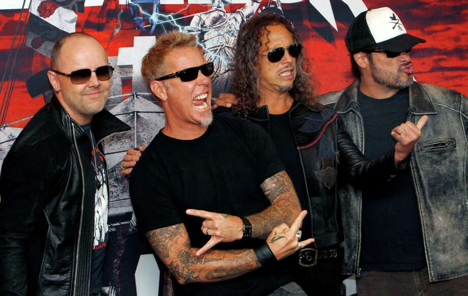 "FILE - In this Saturday, July 28, 2012 file photo, members of the band Metallica, from left to right; Lars Ulrich, James Hetfield, Kirk Hammett and Robert Trujillo, pose  before their first of eight concert performances in Mexico City. Metallica is set to rock the legendary Apollo Theater in Harlem venue on Sept. 21. It will promote their 3D concert-action film ""Metallica Through the Never,"" released in IMAX on Sept. 27 and other theaters a week later. It will also air live on a special temporary Metallica channel on SiriusXM.  (AP Photo/Marco Ugarte, File) ORG XMIT: NY108 Photo: Marco Ugarte / AP"