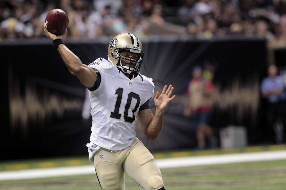 New Orleans Saints quarterback Seneca Wallace (10) passes in the second half of an NFL preseason football game at the Mercedes-Benz Superdome in New Orleans, Friday, Aug. 16, 2013. Photo: Matthew Hinton, Associated Press