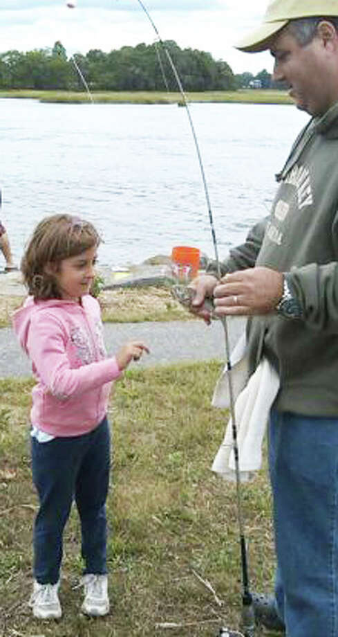Grab the kids and the fishing poles and head down to the South Benson marina Sunday for the Snapper Blue Fishing Derby. Photo: File Photo / Fairfield Citizen
