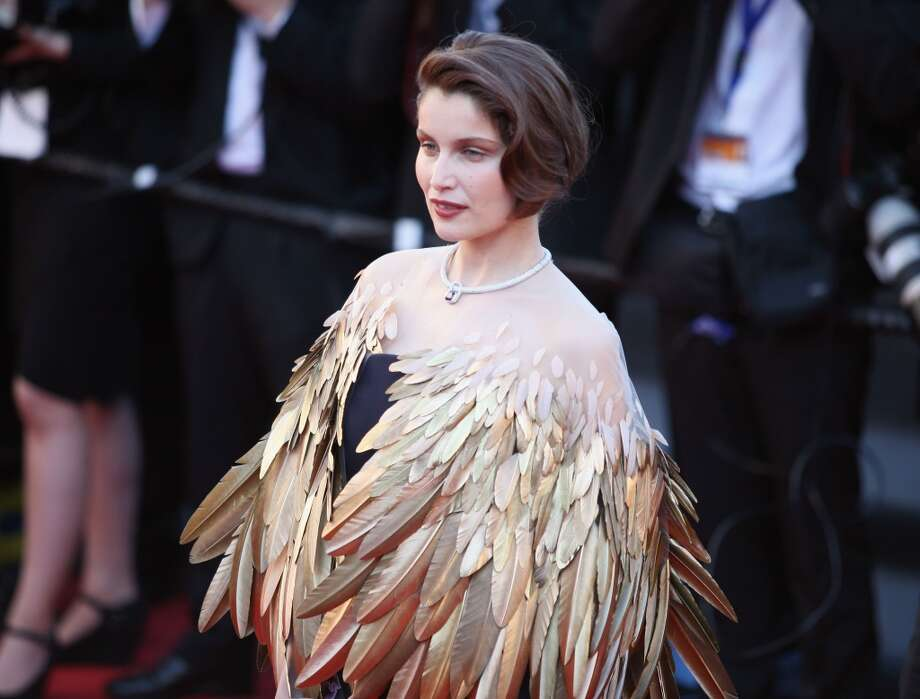 'I really am part bird' feathers (Laetitia Casta) Photo: Traverso/L'Oreal, Getty Images