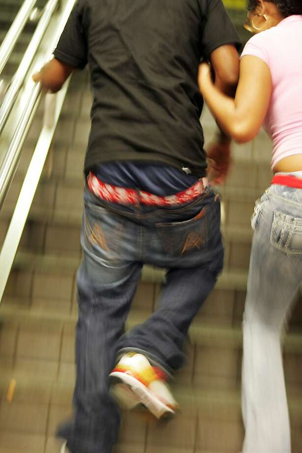 Low-riding pants are the topic of this week's In Defense Of column in Style. Here, Anthoney Figaroa, 20, of Bethlehem, Pa., rushes up a staircase while leaving the subway in New York, Aug. 24, 2007. In several cities across the U.S. there is a growing movement to make it illegal to wear pants so low that the boxers show. Photo: Hiroko Masuike, NYT
