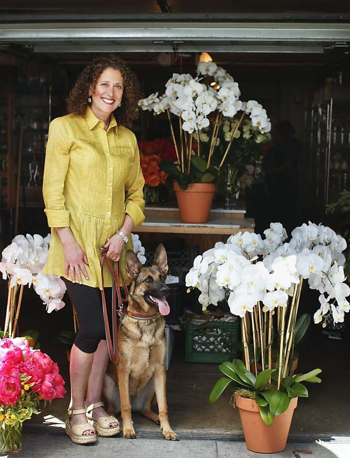 Superstar florist Claire Marie Johnston with Schatzi Marie. Above: Her arrangements are created with elan - and her lips are sealed. Photo: Russell Yip, The Chronicle