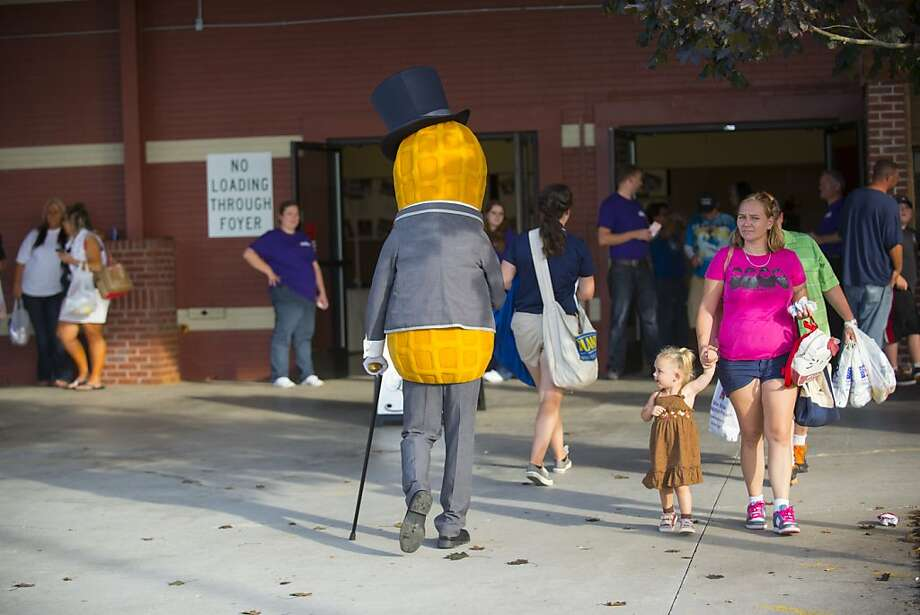 So that's what they look like before they become peanut butter! Mr. Peanut gets 2-year-old Madison Brady's full attention at Food City Race Night in Knoxville, Tenn. Photo: Paul Efird, Associated Press
