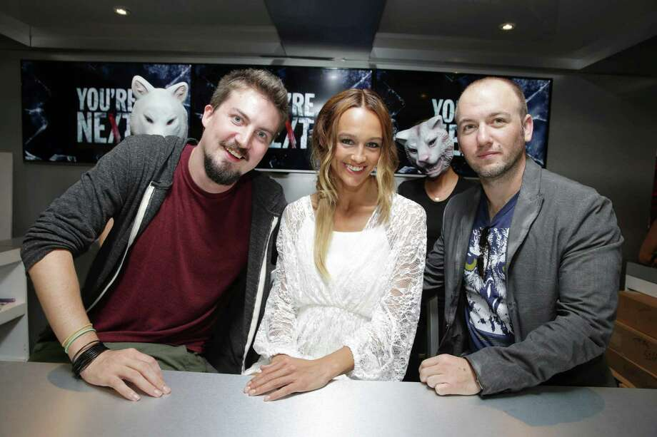 IMAGE DISTRIBUTED FOR LIONSGATE - Director Adam Wingard, Sharni Vinson and Writer Simon Barrett seen at Lionsgate's 'You're Next'  Talent Signing at 2013 Comic-Con, on Thursday, July, 18, 2013 in San Diego, Calif. (Photo by Eric Charbonneau/Invision for Lionsgate/AP Images) Photo: Eric Charbonneau, INVL / Invision