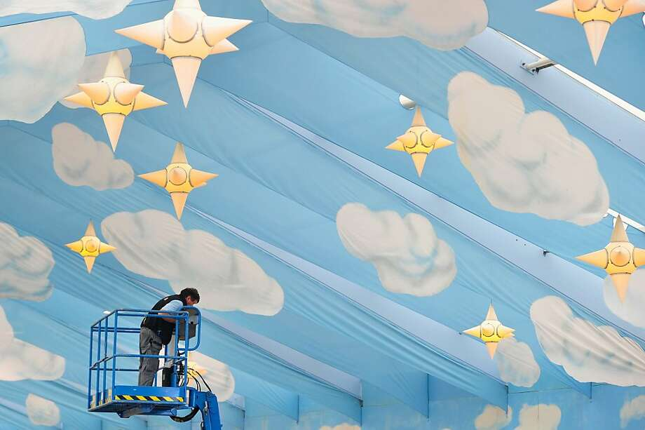 Sudsy skies:A worker secures the roof of the Hacker-Pschorr beer tent during preparation for Oktoberfest, which begins in about a month in Munich. Photo: Lennart Preiss, Getty Images