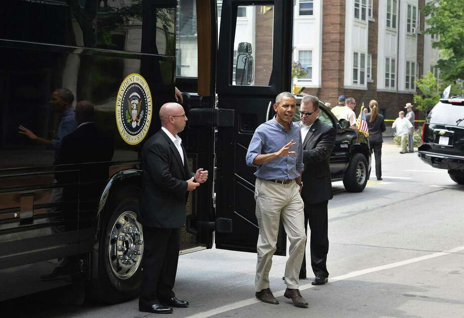 US President Barack Obama gets off his bus at a restaurant to have lunch with a group of students and parents in Rochester, New York, on August 22, 2013. Obama is on a two-day bus tour through New York and Pennsylvania to discuss his plan to make college more affordable, tackle rising costs, and improve value for students and their families. AFP Photo/Jewel SamadJEWEL SAMAD/AFP/Getty Images Photo: JEWEL SAMAD, Getty / AFP