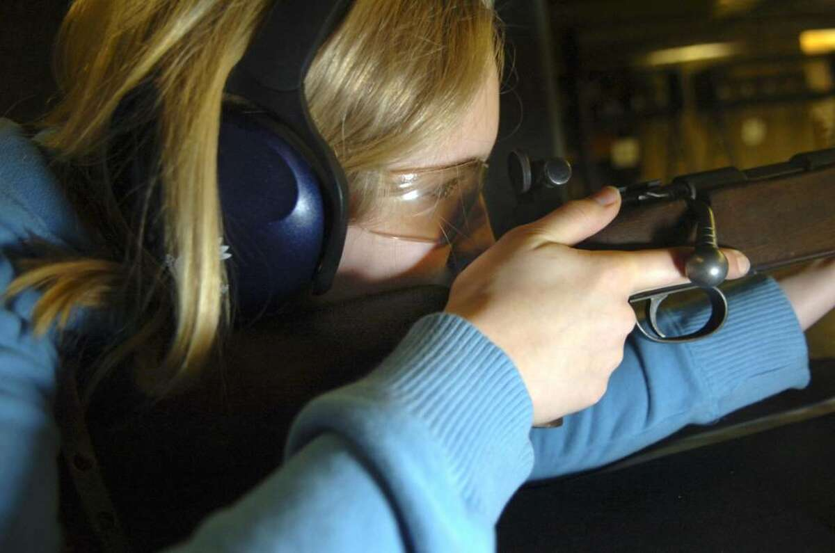 """Greenwich, Jan. 10, 2010. Maddi Wolf, 15, from Girl Scout Troup 50168, a """"High School Troup"""" with one of the rifles at the Cos Cob Revolver and Rifle Club. The girls scouts are learning gun safety and target practice with 22 caliber rifles."""