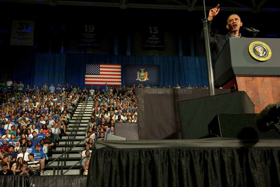 President Barack Obama gestures as he speaks at the University at Buffalo, in Buffalo, N.Y., Thursday, Aug. 22, 2013, beginning his two day bus tour  to speak about college financial aid. (AP Photo/Jacquelyn Martin) ORG XMIT: NYJM113 Photo: Jacquelyn Martin, AP / AP