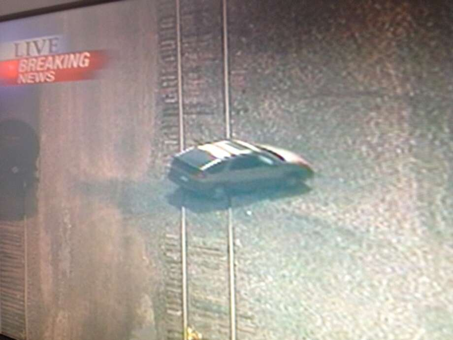 Houston TV stations are following a car chase, which briefly went through a railyard.