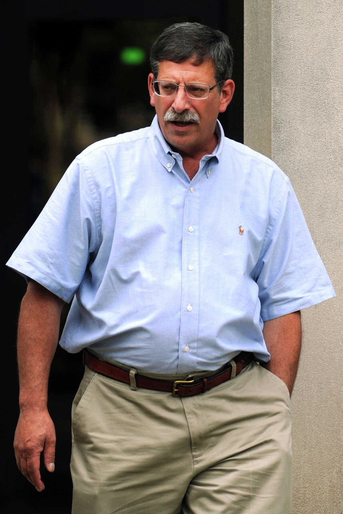 David Laguercia leaves the Federal Courthouse, in Bridgeport, Conn., after pleading guilty to technical violations to federal firearms laws. Laguercia is the owner of Riverview Sales, a gun store in East Windsor where Nancy Lanza bought the semiautomatic rifle that her son, Adam, used at Sandy Hook Elementary School last December.