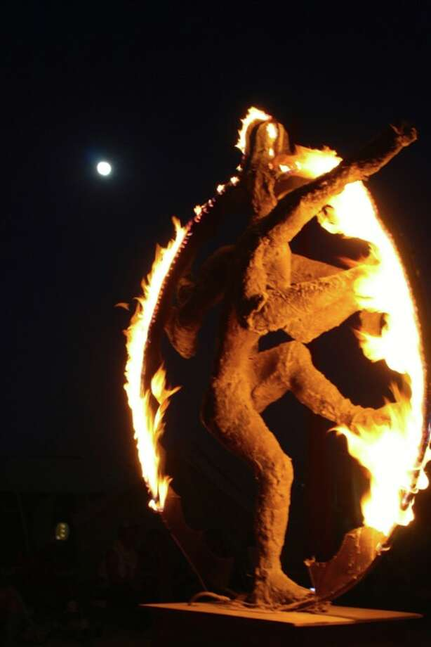 Shiva, aflame, during the full blue moon, in my camp, dinnertime.