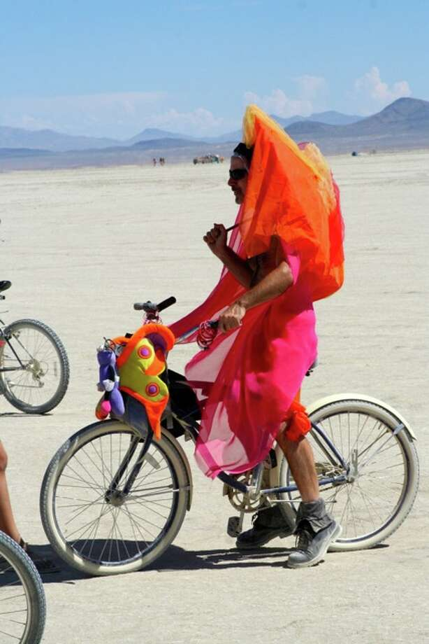 Hot new trend: Umbrellas and cycling in very bright colors. Get on it, fixie nerds