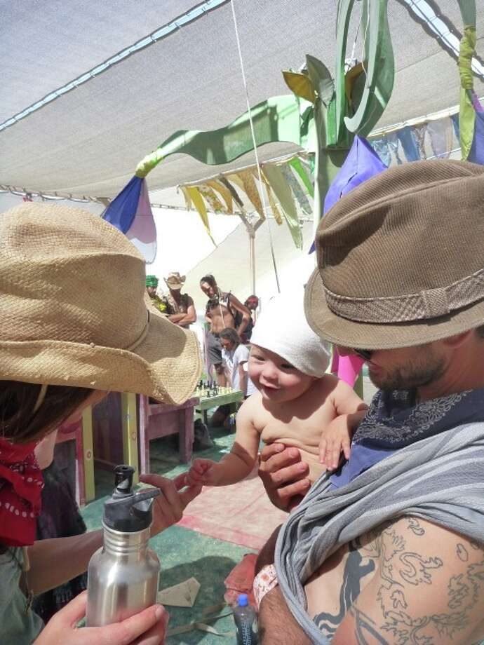 Nearly everyone think it's hugely irresponsible to bring babies to the playa, largely due to the conditions (extreme dust, heat/cold, smoke, noise, etc) and I tend to agree. But this baby was strangely beautiful, magical. So who knows.