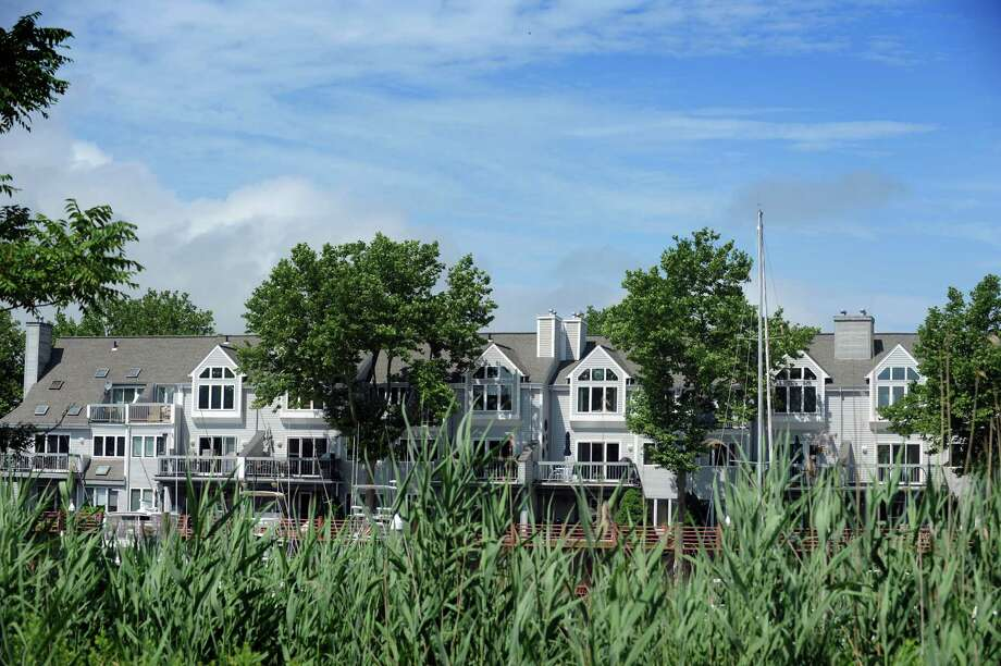 "Breakwater Key condominiums, seen from the $400,000 shared driveway built over airport property and leading to project developer Manuel ""Manny"" Moutinho's waterfront mansion in Stratford, Conn. Photo: Autumn Driscoll / Connecticut Post"