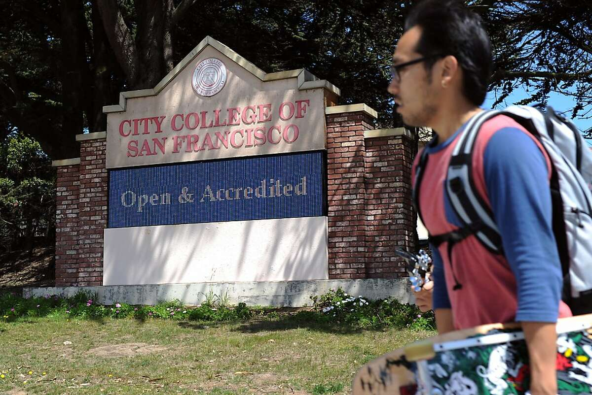 The main sign in front of City College of San Francisco reads that the school is accredited and open for enrollment, in San Francisco, California on Thursday, August 22, 2013.