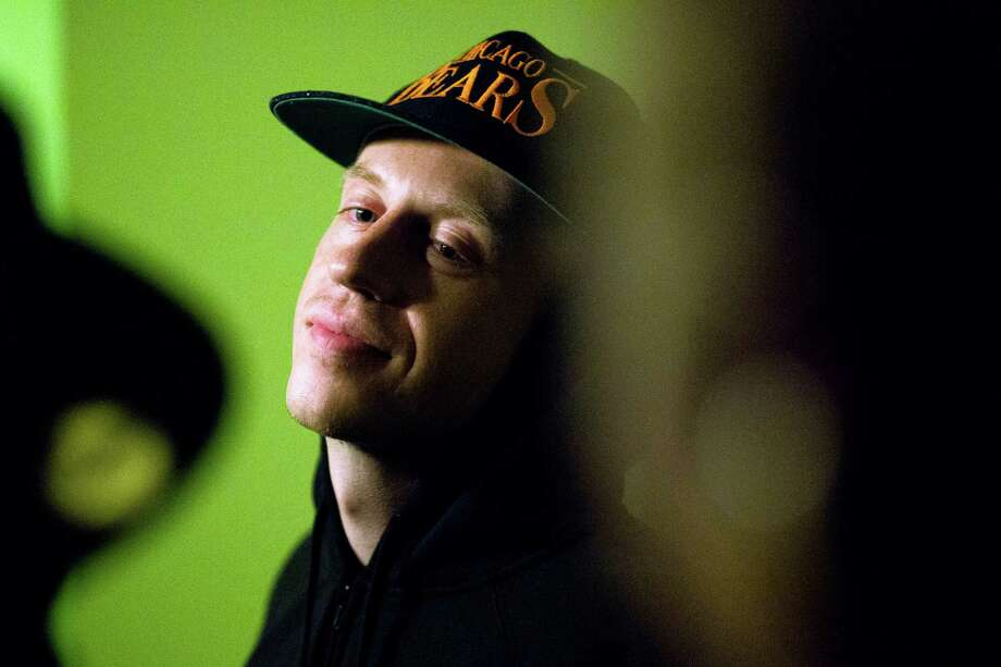 Macklemore hangs out backstage with performing artists during a Bring Our Sonics Back rally and concert Monday, May 13, 2013, at Neumos in Seattle. The free event featured such local hip hop artists as Geo, Grynch, Nacho Picasso and Dyme Def. (Jordan Stead, seattlepi.com) Photo: JORDAN STEAD, Seattlepi.com File Photo / SEATTLEPI.COM