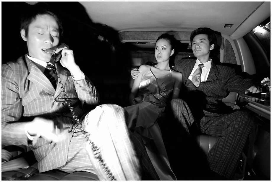 "This black-and-white print, part of the series ""Ms. Huang at M Last Night"" (2006) by Yang Fudong, mimics paparazzo shots and expresses an uncertainty about how to behave as a young adult in China's authoritarian culture. Photo: Yang Fudong"