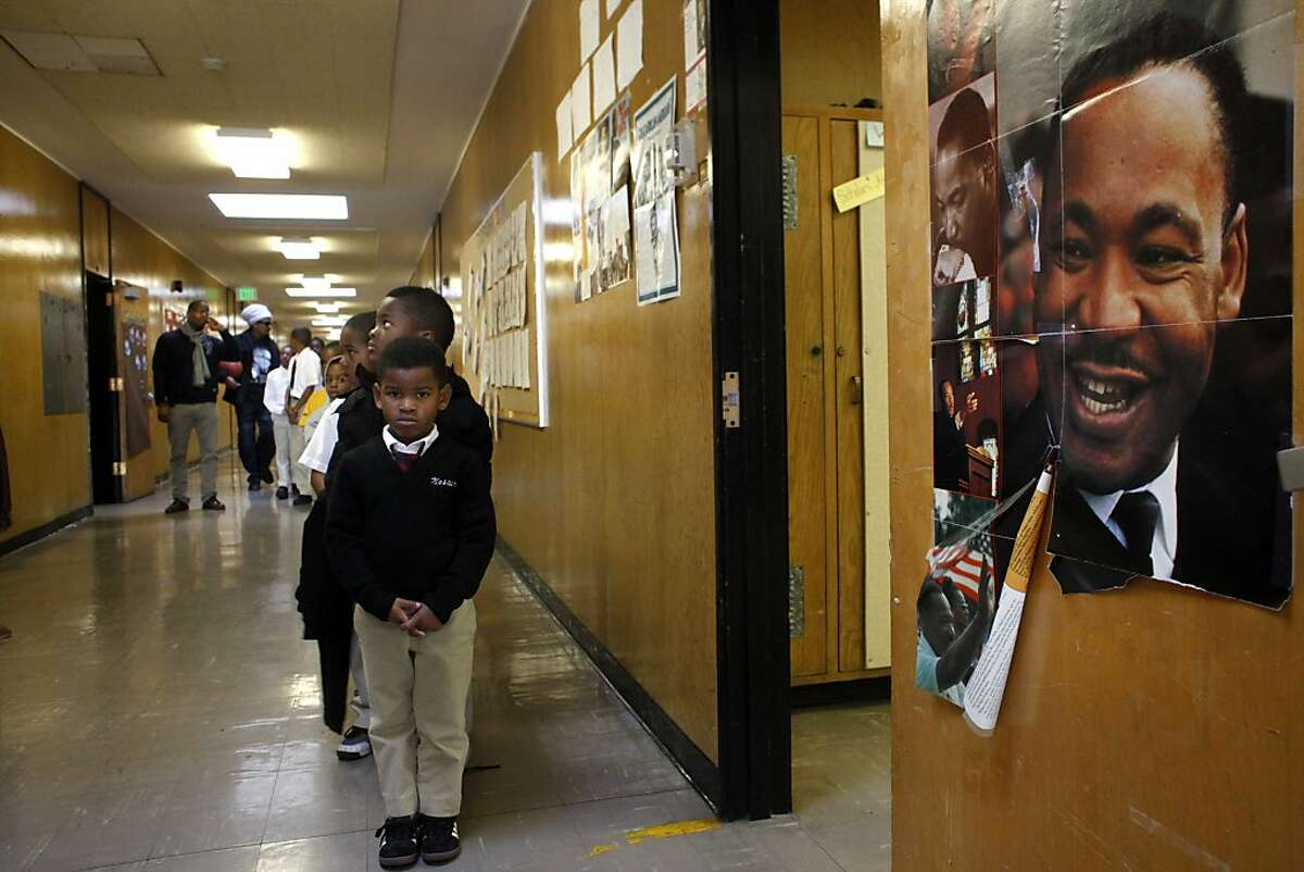 Mr. Xavier Buster's kindergardener class line up as they return to class after lunch, Friday April 12, 2013, at the100 Black Men Community Charter School in Oakland, Calif.