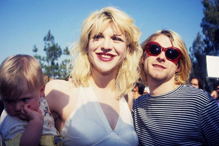 Courtney Love poses with Kurt Cobain and daughter Frances Bean Cobain at the 1993 Video Music Awards. Photo: Terry McGinnis, WireImage