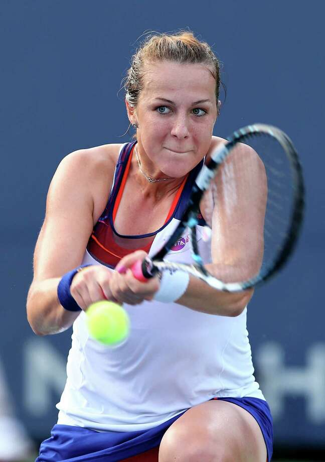 NEW HAVEN, CT - AUGUST 22:  Anastasia Pavlyuchenkova of Russia returns a shot to Petra Kvitova of the Czech Republic during Day Five of the New Haven Open at Yale at the Connecticut Tennis Center on August 22, 2013 in New Haven, Connecticut. Photo: Elsa, Getty Images / 2013 Getty Images