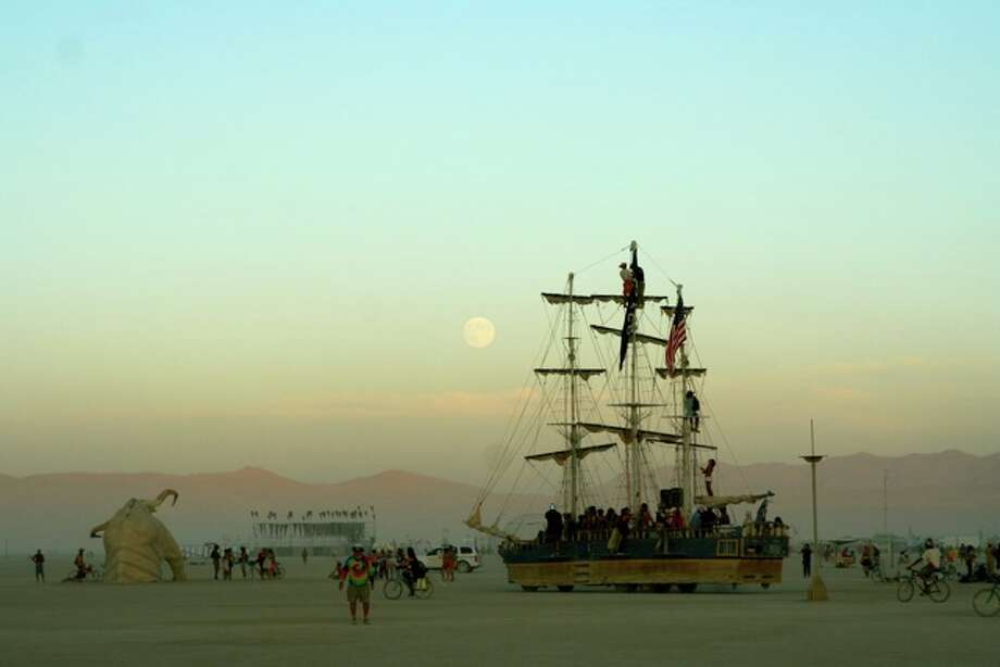 My fave time of day: right around sundown, the air still incredibly warm, the playa calm and mellow as the Monaco goes cruising by under a full and pregnant moon before everyone heads to their camps to eat and prepare to come back out and cruise/party/dance/ogle the moon all night.