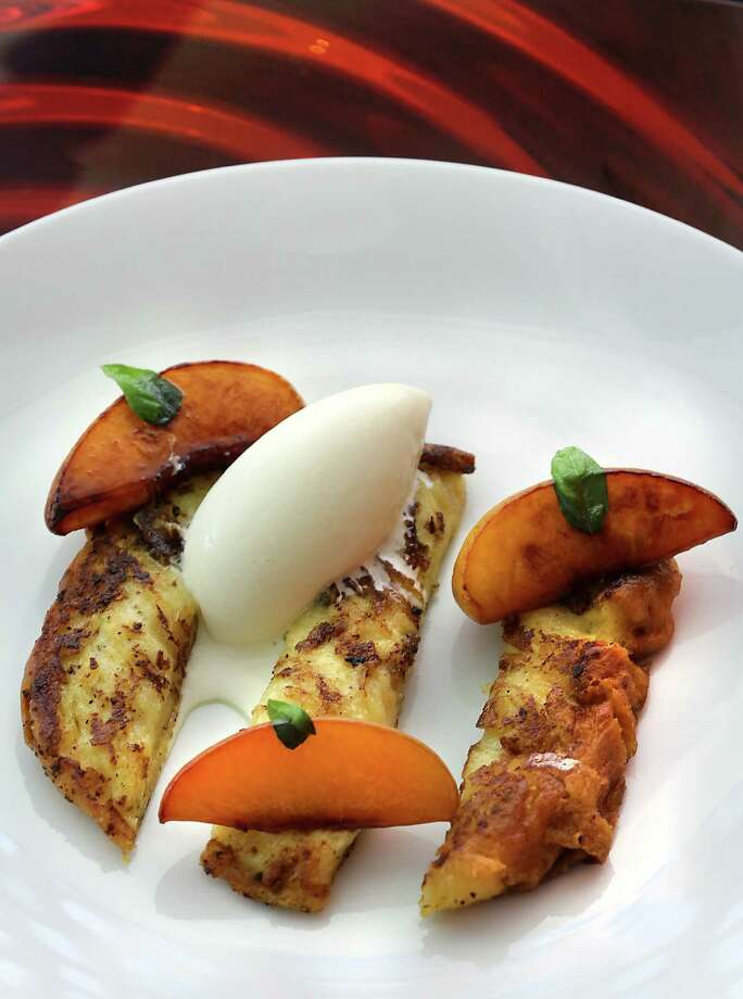 Saveurs 209 on Broadway serves Brioche French Toast with Honey Roasted Peaches and Basil Ice Cream.