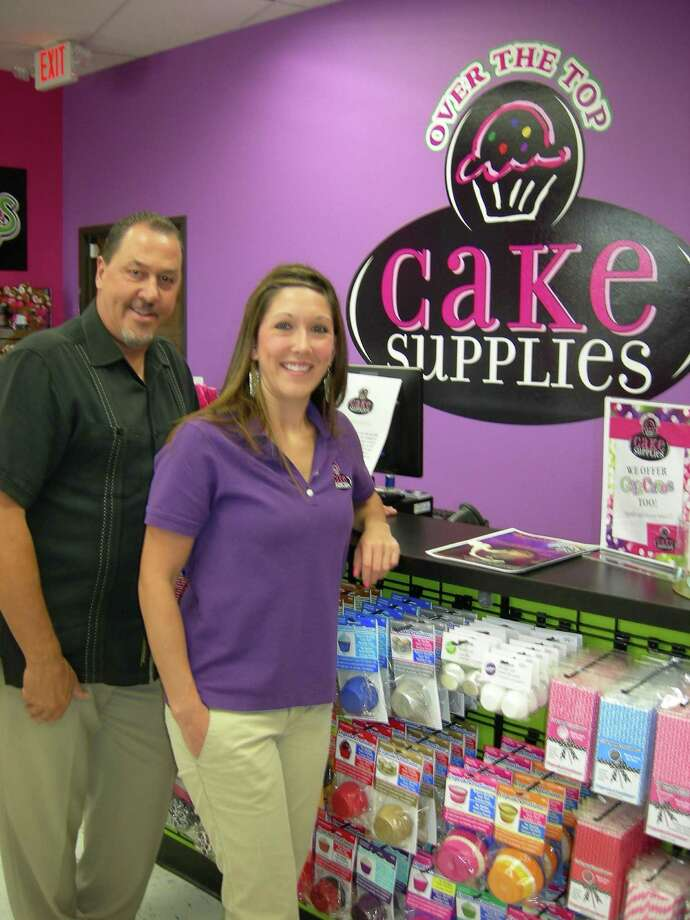 Owner Kevin Johnson and retail manager Chelsey Cure offer baking items at Over the Top Cake Supplies.