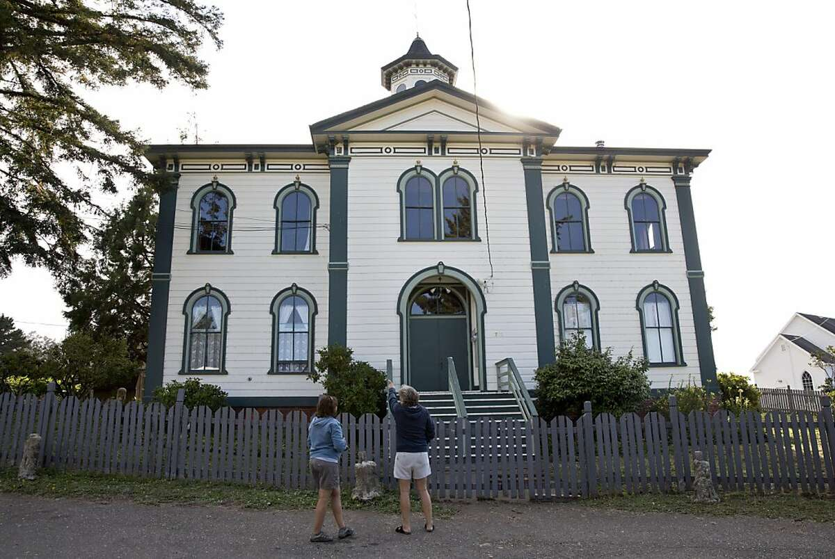 Andrea Eftim (left) and Ryan Mercik visit the old Potter Schoolhouse, which was used as a filming location for The Birds in Bodega, Calif., on Sunday, August 11, 2013. This year is the 50th anniversary of The Birds, an Alfred Hitchcock movie, which was filmed in Bodega and Bodega Bay. The building is now a private residence.