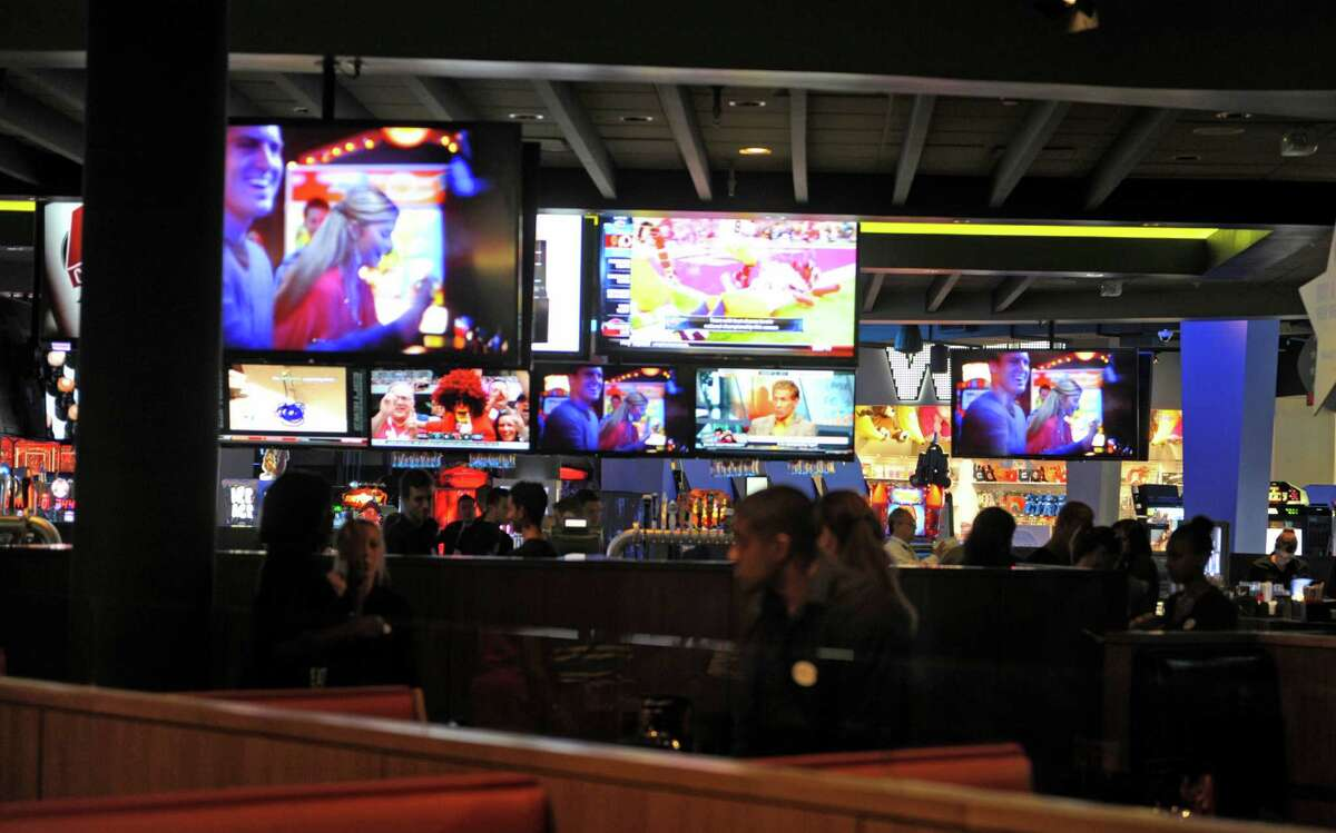 Large television monitors hang from around the bar area at the new Dave & Buster's, a restaurant/arcade in Crossgates Mall on Thursday, Aug. 22, 2013 in Guilderland, NY. (Paul Buckowski / Times Union)
