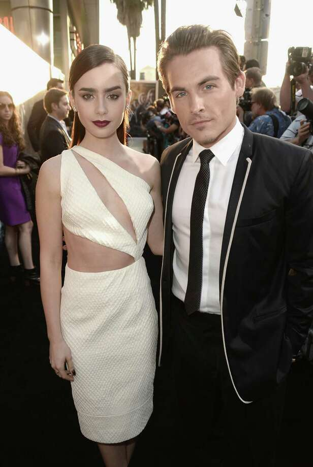 """Actors Lily Collins and Kevin Zegers attend the premiere of Screen Gems & Constantin Films' """"The Mortal Instruments: City of Bones"""" at ArcLight Cinemas Cinerama Dome on Aug. 12, 2013 in Hollywood, Calif. Photo: Kevin Winter, Getty Images / 2013 Getty Images"""