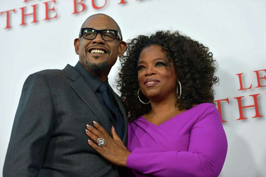 Actor Forest Whitaker and Oprah Winfrey attend LEE DANIELS' THE BUTLER Los Angeles premiere, hosted by TWC, Budweiser and FIJI Water, Purity Vodka and Stack Wines, held at Regal Cinemas L.A. Live on Aug. 12, 2013 in Los Angeles. Photo: Charley Gallay, Getty Images For TWC / 2013 Getty Images