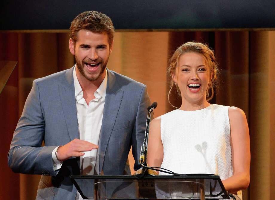 Actors Liam Hemsworth and Amber Heard speak onstage at the Hollywood Foreign Press Association's 2013 Installation Luncheon at The Beverly Hilton Hotel on Aug. 13, 2013 in Beverly Hills, Calif. Photo: Mark Davis, Getty Images / 2013 Getty Images