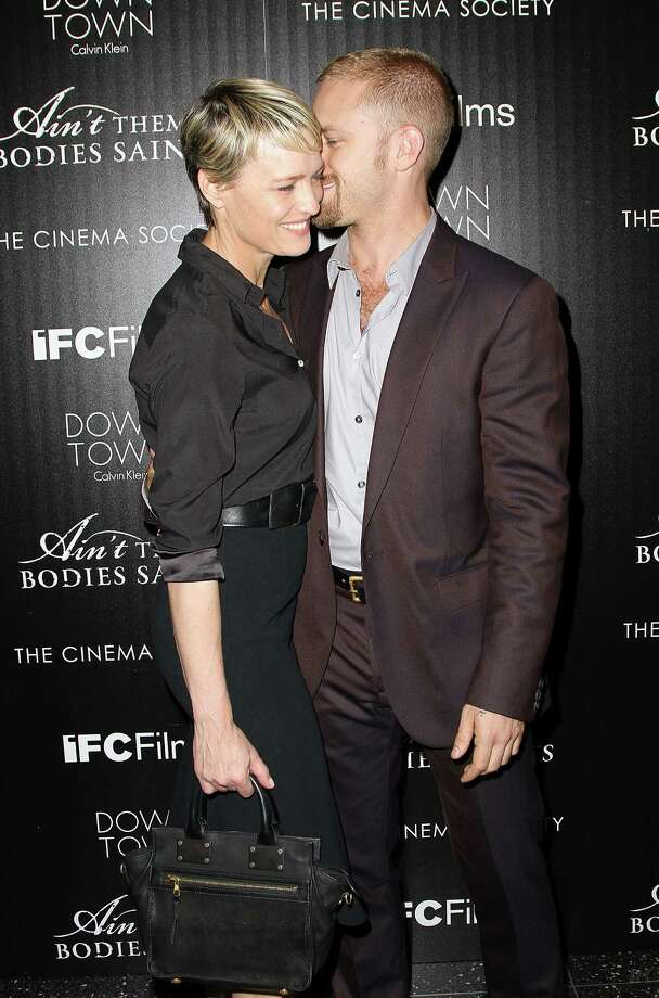 "Actress Robin Wright and actor Ben Foster attend the Downtown Calvin Klein with The Cinema Society screening of IFC Films' ""Ain't Them Bodies Saints"" at The Museum of Modern Art on Aug. 13, 2013 in New York. Photo: Monica Schipper, FilmMagic / 2013 Monica Schipper"