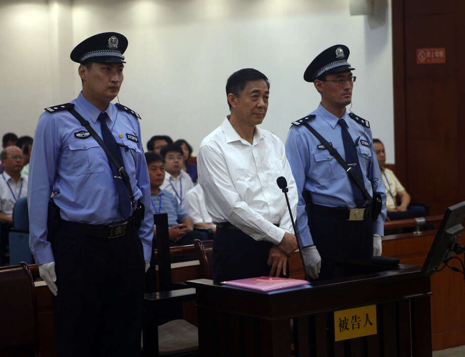 In this photo released by the Jinan Intermediate People's Court, Bo Xilai, center, stands on trial at the court  in eastern China's Shandong province on Thursday Aug. 22, 2013.  Disgraced populist politician Bo Xilai went on trial Thursday accused of abuse of power and netting more than $4 million in bribery and embezzlement, marking the ruling Communist Party's attempts to put to rest one of China's most lurid political scandals in decades. (AP Photo/Jinan Intermediate People's Court) Photo: HOPD /  Jinan Intermediate People's Cou