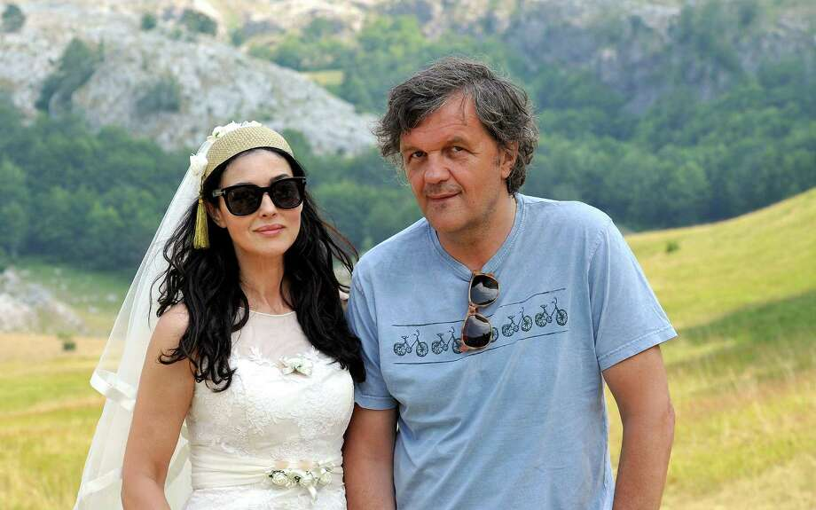 "Italian actress Monica Bellucci (L) stands with internationally acclaimed Serbian director Emir Kusturica on the set of his new movie entitled ""The Milky Road"", near the town of Gacko, southeastern Bosnia on Aug. 14, 2013. Bellucci has started filming for the new movie ""The Milky Road"", expected to be presented in Cannes in 2014. Photo: AFP, AFP/Getty Images / 2013 AFP"