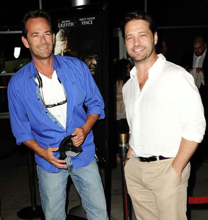"Actors Luke Perry and Jason Priestley attend the premiere of ""Dark Tourist"" at ArcLight Hollywood on Aug. 14, 2013 in Hollywood, Calif. Photo: Jason LaVeris, FilmMagic / 2013 Jason LaVeris"