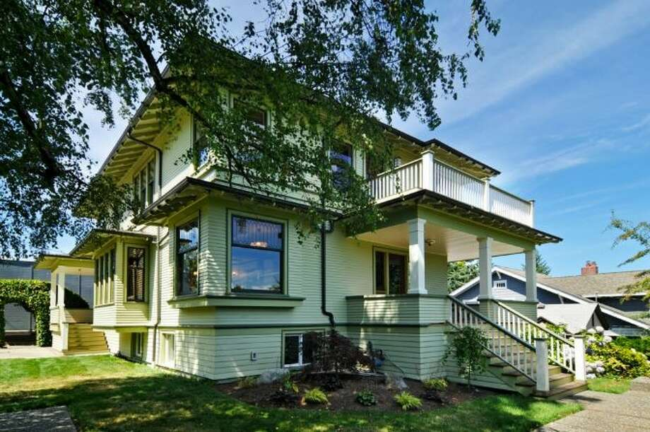 Capitol Hill is known for its classic Craftsman homes. A good example on the market right now is 2405 Federal Ave. E. The 3,885-square-foot house, built in 1907, has four bedrooms, 3.5 bathrooms, two fireplaces, dark-stained trim, beamed ceilings, leaded glass, built-ins, French doors, a family room, a rec room, a den, a wine cellar, a front porch and a balcony on a 6,000-square-foot lot. It's listed for $1.45 million. Photo: Courtesy Leslie Ota, Windermere Real Estate