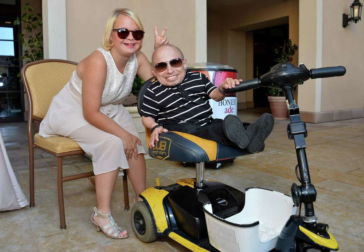 Actress Lauren Potter (L) and actor Verne Troyer attend the Team Maria benefit for Best Buddies at Montage Beverly Hills on Aug. 18, 2013 in Beverly Hills, Calif.