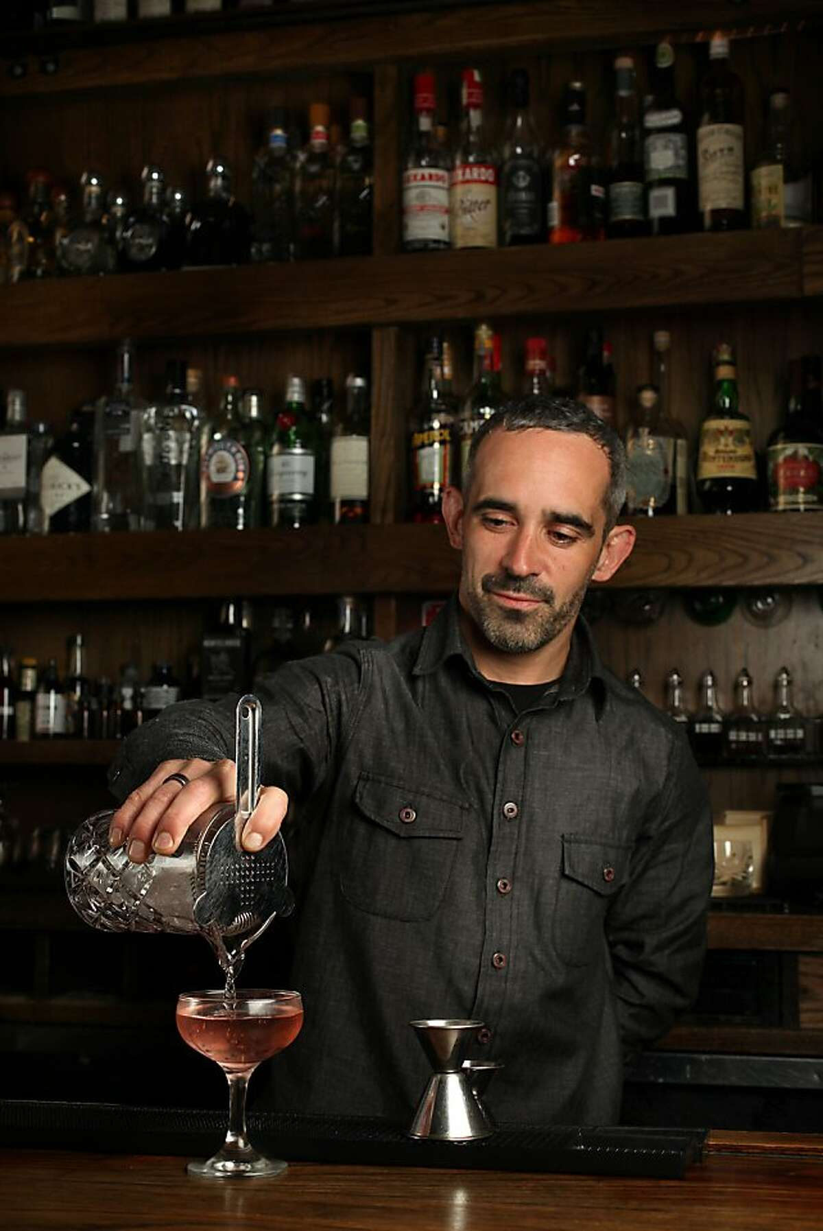 """Bartender Matty Conway makes a """"Knife in the Water"""" at Rickhouse in San Francisco, Calif., on Tuesday, August 13, 2013."""