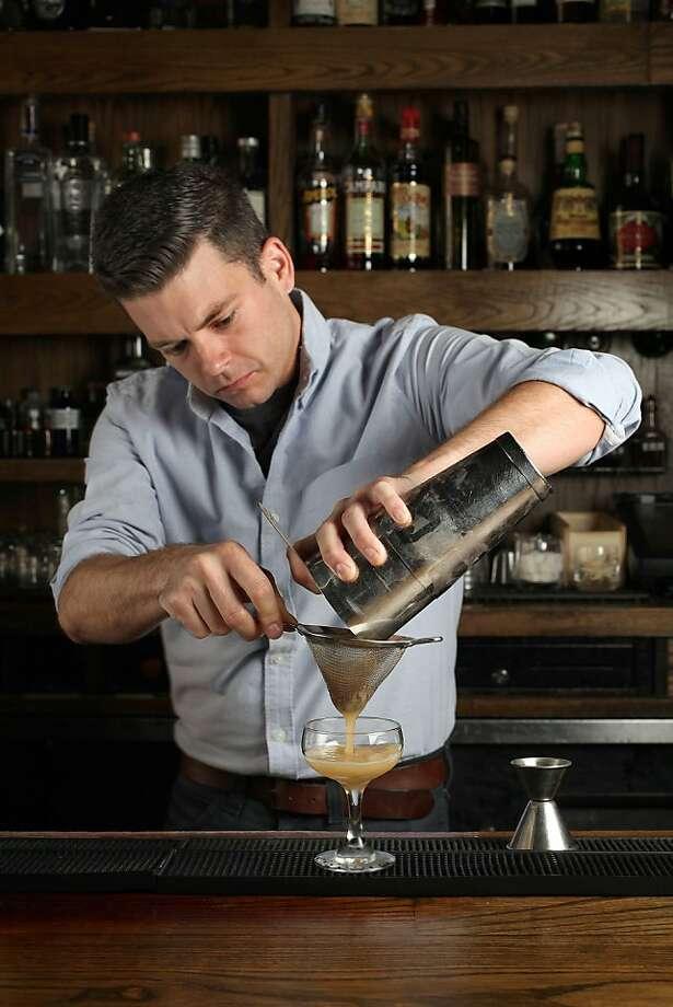 "Bartender Michael Lay makes a ""Far East Daquiri"" at Rickhouse in San Francisco, Calif., on Tuesday, August 13, 2013. Photo: Liz Hafalia, The Chronicle"