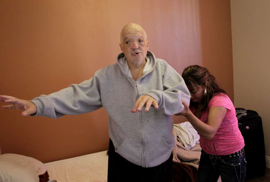 Edith Gonzalez, an on call caregiver with In Home Support Services helps, Tim Martin rise from his bed at the Baldwin Hotel in the spring of 2013. Martin, who was blind, deaf and unable to speak, arrived in San Francisco in the spring of 2013. He died Nov. 4, 2015, at Laguna Honda Hospital. Photo: Brant Ward, The Chronicle