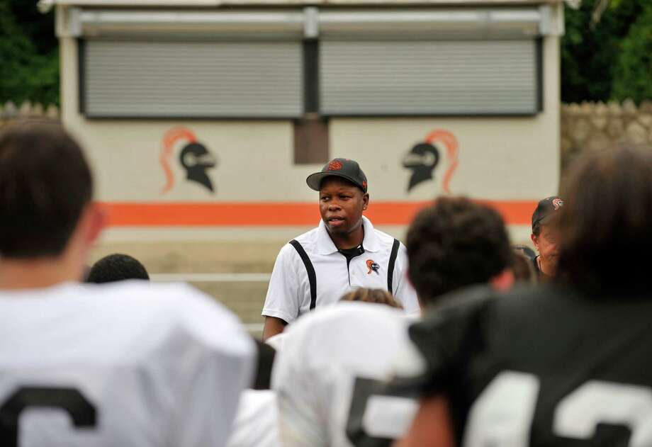 First year head coach Jamar Greene talks to his team during the Knights' practice at Stamford High School on Thursday, Aug. 22, 2013. Photo: Jason Rearick / Stamford Advocate