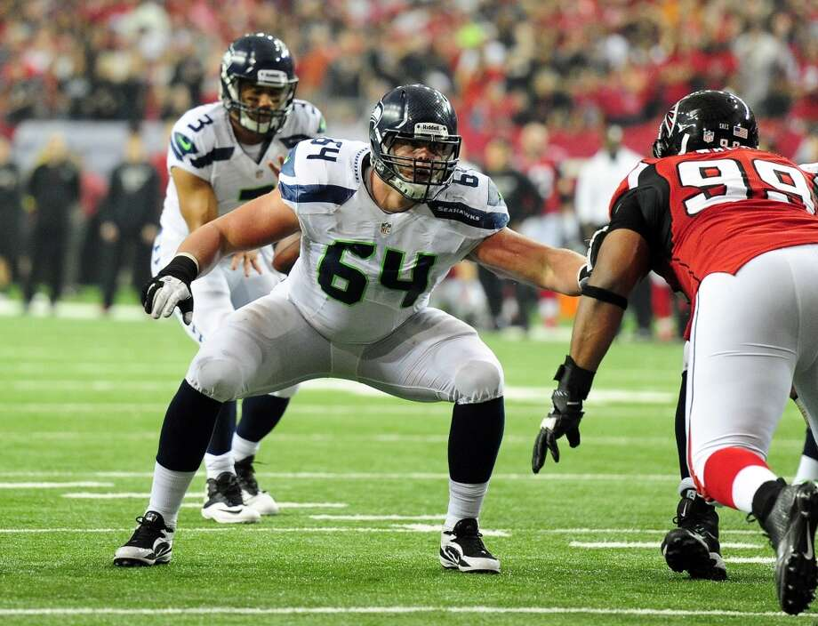 3. The offensive line  The Seahawks traded guard John Moffitt, a starter for two years when he wasn't injured or suspended, to the Cleveland Browns on Monday. When that trade fell through, Seattle sent him to the Denver Broncos on Tuesday in exchange for a little-known defensive end. Obviously, Carroll and Co. have settled on second-year lineman J.R. Sweezy (pictured) at right guard. For now, at least.  The Moffitt trade understandably raised some eyebrows this week. Seattle selected him in the third round of the 2011 draft, and it's never a good sign when a team drops a former mid-round pick. Can Sweezy, whom the Seahawks converted from a defensive tackle, rise to the call?  Watch him and the other O-linemen this week as the Seahawks figure out their pass protection. It will be interesting to see what Seattle does when guard James Carpenter, a former first-round pick, returns from a foot injury. (Carroll on Thursday said Carpenter will practice next week and hopefully play in Seattle's final preseason game against the Raiders.) Photo: Scott Cunningham, Getty Images