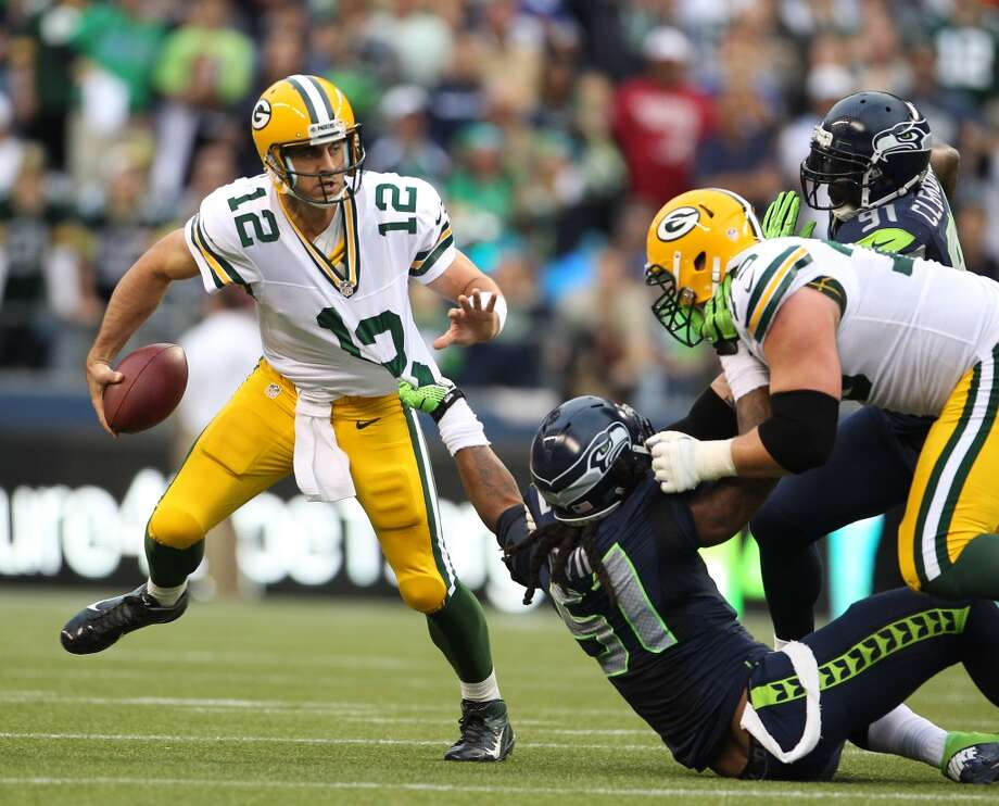 5. The pass rush  Last year, when the Seahawks beat the Packers in Week 3, Green Bay quarterback Aaron Rodgers got sacked eight times -- eight times -- in the first half. Four of them were by defensive end Chris Clemons, and two of them were by Bruce Irvin. Both of those guys are sidelined for the time being, Clemons after his off-season ACL surgery and Irvin with his injured groin. Irvin will actually be a game-time decision, Carroll said Thursday, but then there's the matter of his four-game suspension once the regular season begins.  Meanwhile, off-season acquisition Cliff Avril -- who led the Detroit Lions in sacks last season with 9.5 -- returned to practice just last week after nursing a sore hamstring. Carroll said he's a game-time decision for Friday. We've seen some good work out of Michael Bennett, another off-season signee, though Carroll wants to see more. Also keep an eye on rookie Benson Mayowa, who has been making a strong case for himself at D-end.  Also on the defensive line, Tony McDaniel -- yet another off-season acquisition -- will get the start at left defensive tackle as the Seahawks try to figure him out. Rookie DT Jordan Hill will sit with an injury, as will fellow rookie DT Jesse Williams. Carroll said Bennett could see some time Friday at DT, as well, and of course there are the bubble players like Martin Parker, Jaye Howard and Michael Brooks. Watch to see how well those guys fill Seattle's hole at left DT. Photo: Kevin Casey, Getty Images
