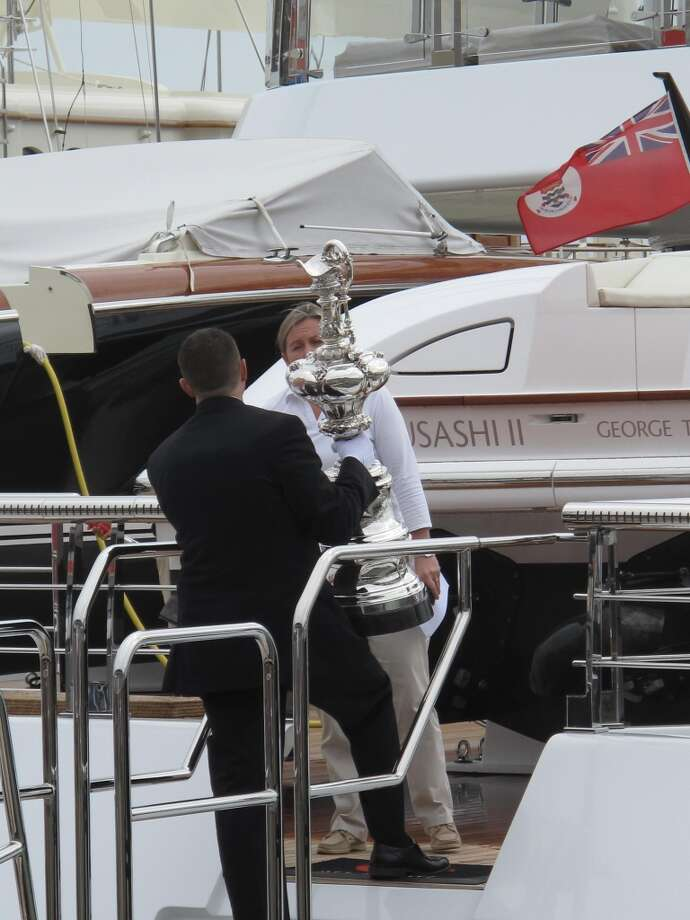 America's Cup Park pier, Aug. 21, 2013; Trophy is taken off Larry Ellison yacht. It's been ubiquitous as socialites' diamonds for months. Photo: Leah Garchik
